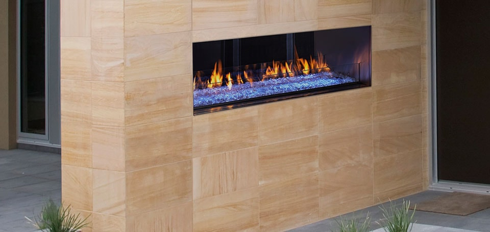 Palazzo See-Through Gas Fireplace shown with blue LED lighting